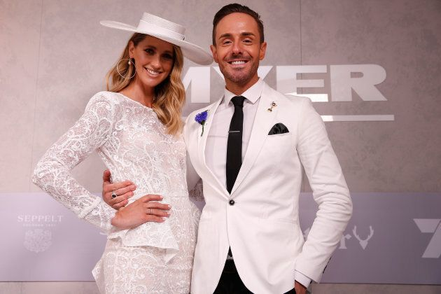Nikki Phillips and Donny Galella pose at the Myer Fashion on the Field