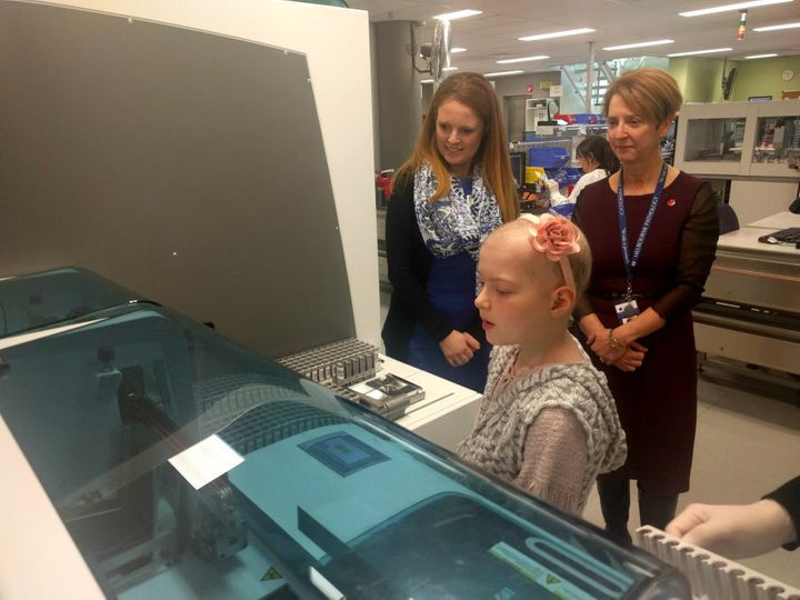 Bridgette with her mother Sharon and Dr Maxwell during their visit to Melbourne Pathology.