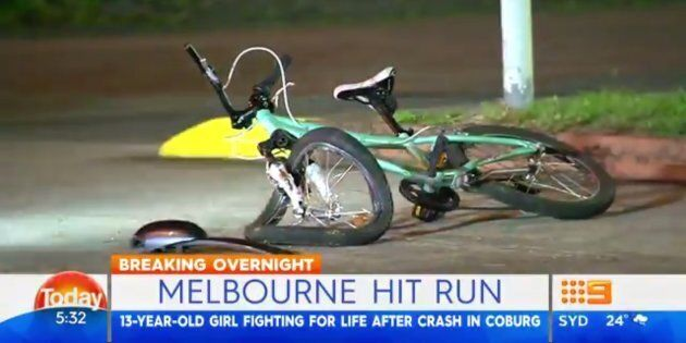 The girl's pale blue and pink bicycle lay crumpled on the footpath at the scene of the