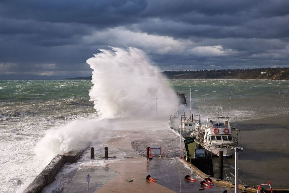 This image of a wave crashing over Mornington Pier in Port Phillip Bay was taken while a strong cold...