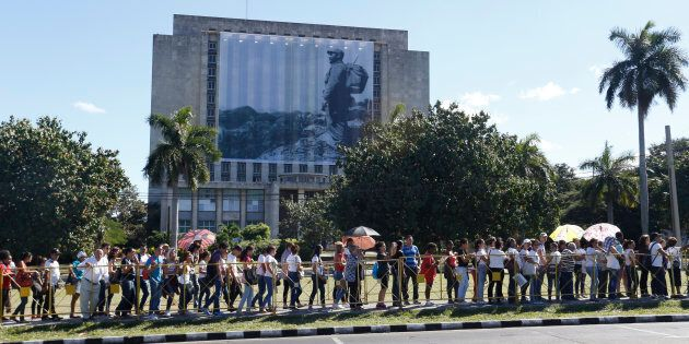 People wait in line to reach Revolution Square to pay tribute to Cuba's late President Fidel Castro in Havana, Cuba, November 28, 2016.