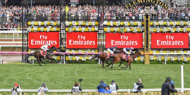 Rekindling (GB) ridden by Corey Brown wins the Emirates Melbourne Cup at Flemington Racecourse on November 07, 2017 in Flemington, Australia. (Mike Keating/Racing Photos via Getty Images)