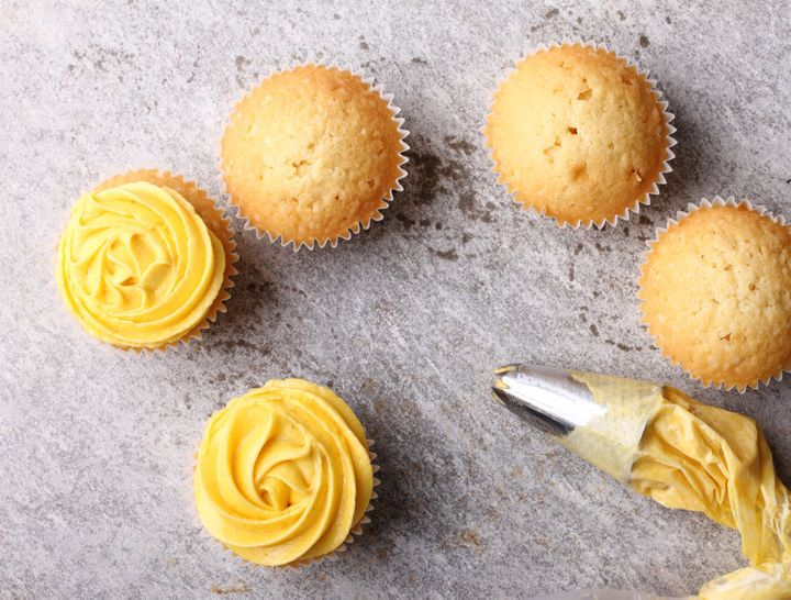 Finish your cupcake with buttercup rose frosting.