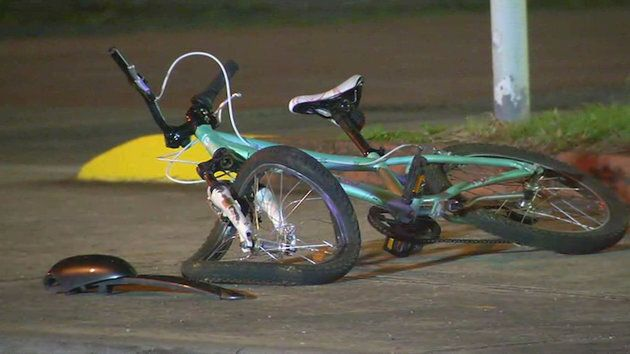The girl's crumpled bicycle at the scene of the