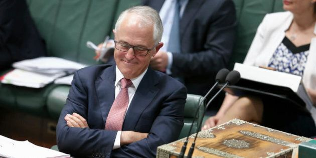 Malcolm Turnbull resumes his seat after