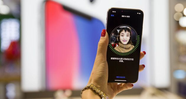 Setting up Face ID is easy. It scans your face while you draw an imaginary circle with your nose in the...