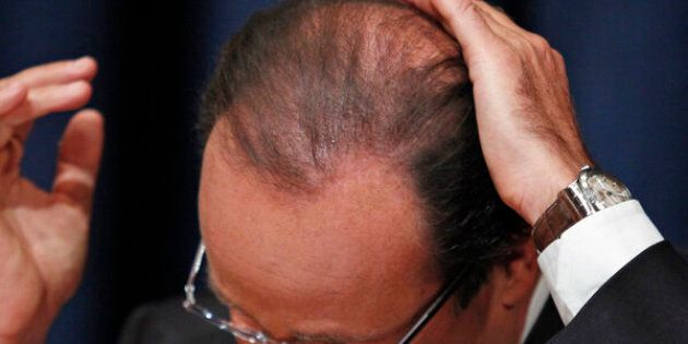 France's President Francois Hollande smoothes down his hair during a news conference following his speech at the 67th United Nations General Assembly at the U.N. headquarters in New York September 25, 2012. REUTERS/Eduardo Munoz (UNITED STATES - Tags: POLITICS)