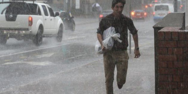 The Brisbane CBD copped a soaking when a storm hit south-east Queensland on