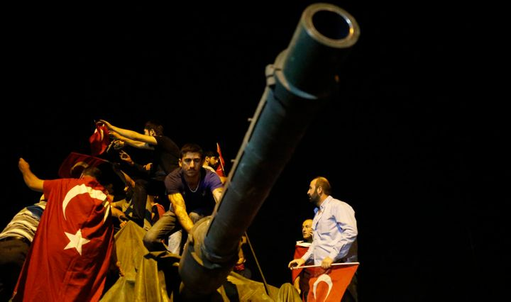 People surround a Turkish army tank in Ankara.