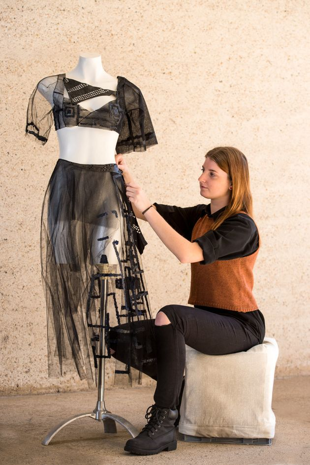 Alexandra Bell, Bachelor of Fashion Design student, with one of her designs incorporating