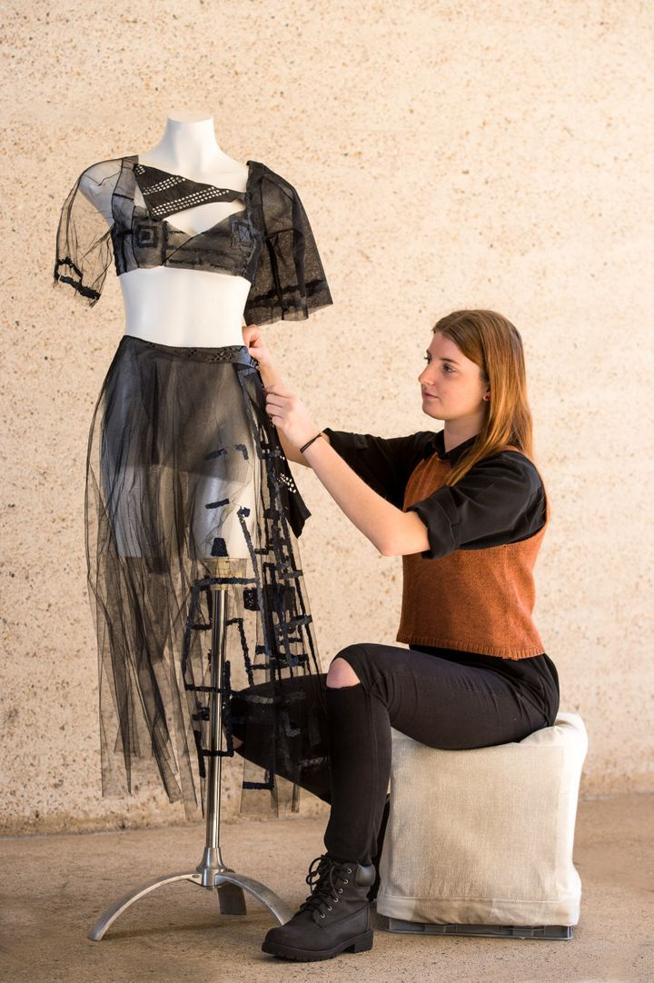 Alexandra Bell, Bachelor of Fashion Design student, with one of her designs incorporating Kombucha.
