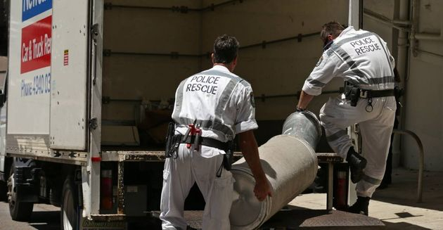 Rescue squad police loading equipment seized during the