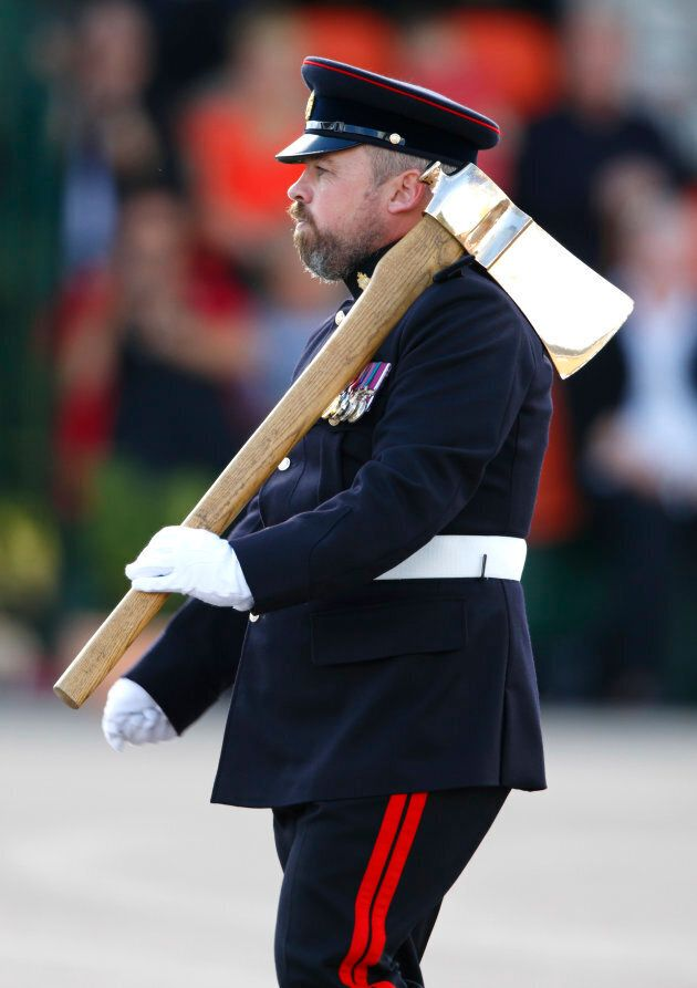 A bearded Pioneer Sergeant (the only soldier in the British Army allowed to wear a beard) carries a Pioneer Axe (the symbol of the Pioneer Regiment) during the 23 Pioneer Regiment RLC Disbandment Parade at St David's Barracks on Sept. 26, 2014 in Bicester, England.