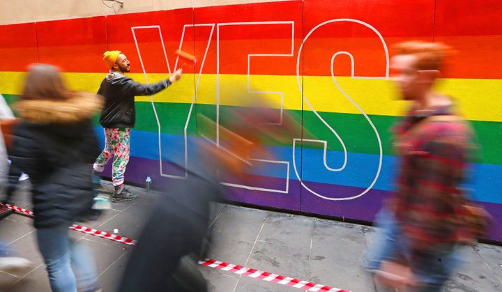 Melbourne, Australia -- August 27:  Artist David Lee Pereira paints a marriage equality mural on a wall.