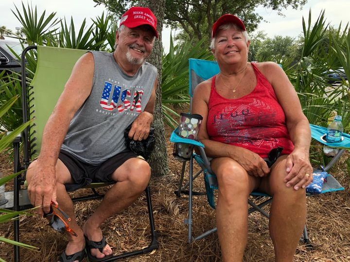 Ronnie and Beth Thompson sit outside while waiting for President Donald Trump's rally to start in Panama City Beach, Florida.