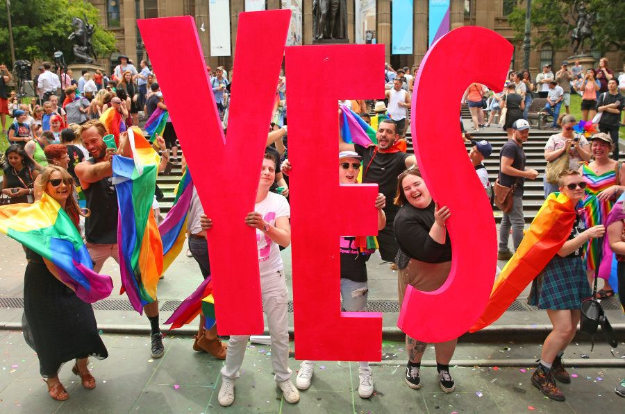 Melbourne, Australia -- November 15: That's a big fat YES! People in the crowd celebrate as the result...