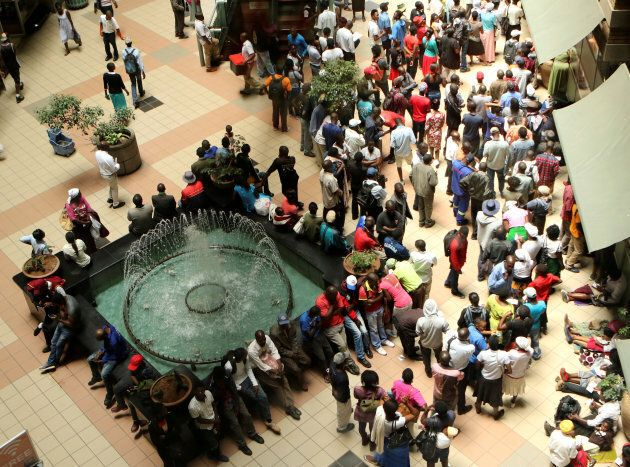 Amidst political uncertainty, Zimbabweans are waiting in long queues to withdraw limited supplies of...