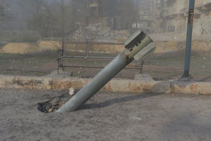 An unexploded missile is seen after warcrafts belonging to Syrian army carried out airstrikes on the opposition controlled areas in Aleppo's Sukkeri region, Syria on December 4, 2016.