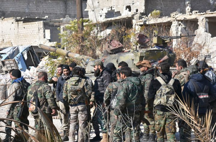 Syrian pro-government forces gather in the Myessar district in east Aleppo as they advance to recapture all of the battered second city, on December 4, 2016.