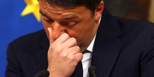 Italian Prime Minister Matteo Renzi gestures during a media conference after a referendum on constitutional...
