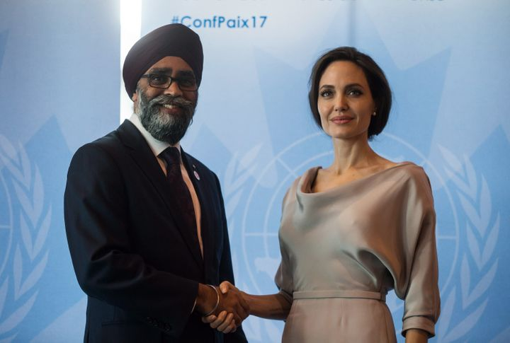 Defence Minister Harjit Sajjan, left, and UNHCR Special Envoy Angelina Jolie pose for photos before her keynote address at the 2017 United Nations Peacekeeping Defence Ministerial conference in Vancouver on Wednesday.