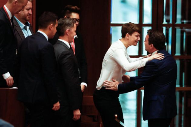 Senator Dean Smith embraces supporters of the Yes campaign after speaking during debate on the Marriage Amendment bill in the Senate