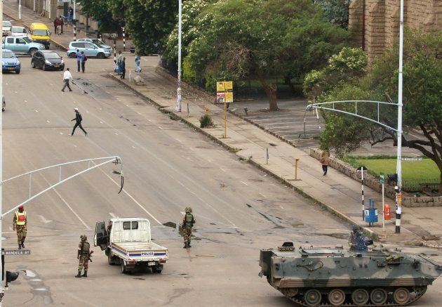 Soldiers stand on the streets in Harare, Zimbabwe, on November 15,