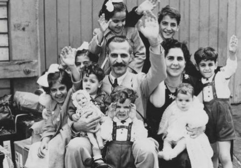 New Australians: Mr and Mrs John Manche with their family of nine children on the wharf at Circular Quay,...