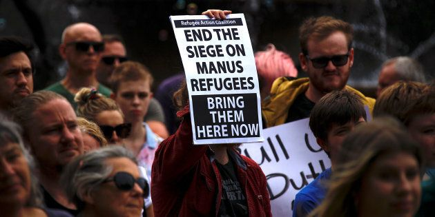 Refugee advocates hold placards as they participate in a protest in Sydney, Australia, against the treatment...