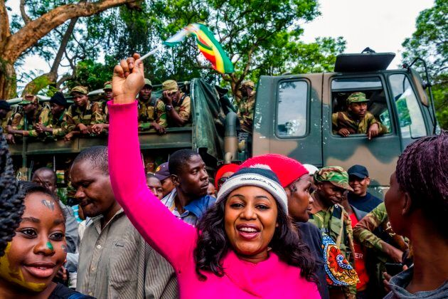 Zimbabwean soldiers block the way to people who demonstrate to demand the resignation of Zimbabwe's president...