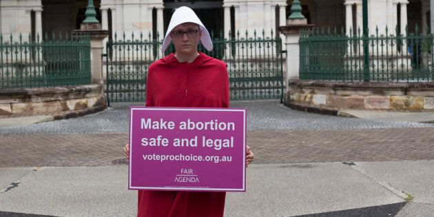 One of Fair Agenda's handmaids, pushing for the decriminalisation of abortion.