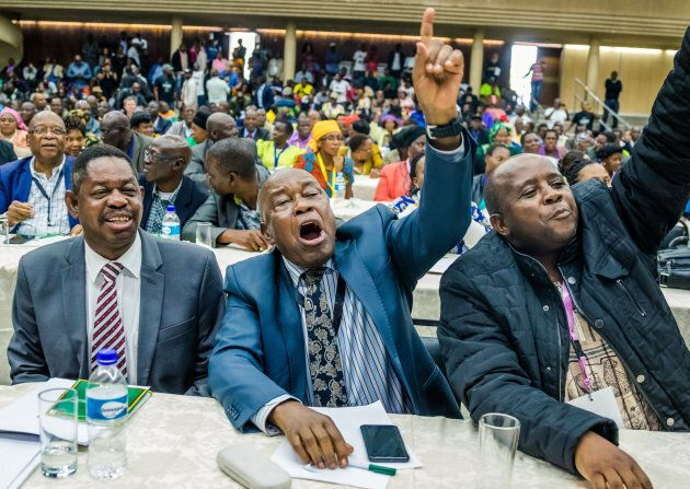 War Veterans leader Christopher Mutsvangwa (centre) celebrates the dismissal of the president of the ruling ZANU-PF party on November 19, 2017 in Harare.