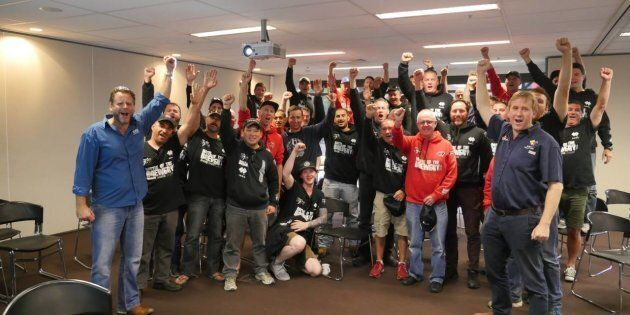 The CUB55 workers celebrate after agreeing to a new