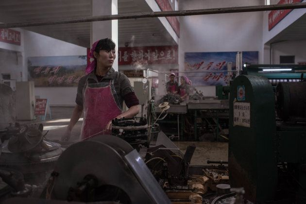 A worker processes silk at the Kim Jong Suk Silk Mill in