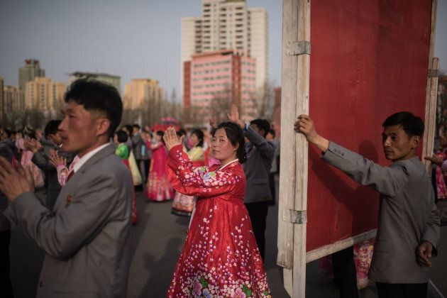 North Korean students take part in a mass dance event in