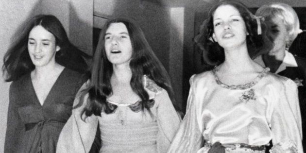 'Manson Family' members Susan Atkins, Patricia Krenwinkel and Leslie Van Houten hold hands as they walk...