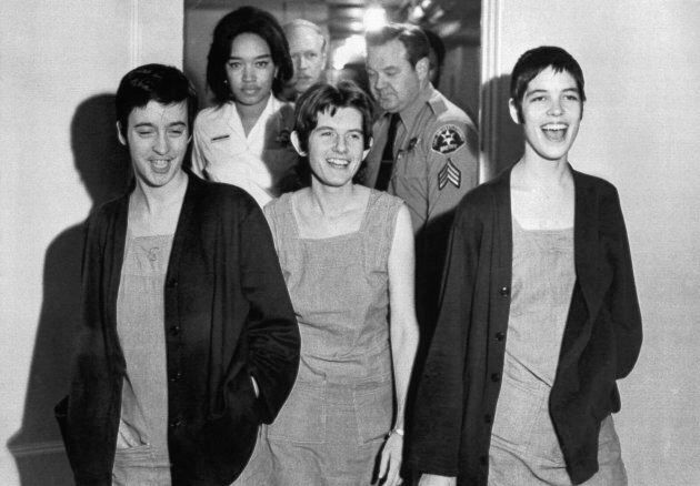 Susan Denise Atkins, (left), Patricia Krenwinkel and Leslie Van Houten,(right), laugh after receiving...