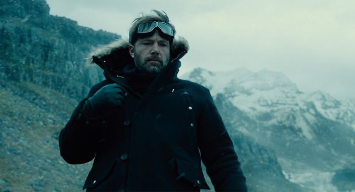 Ben Affleck as Batman whose superpowers include vast wealth and looking melancholy in various headgear.