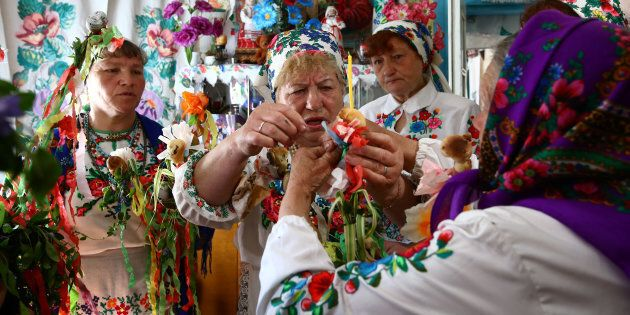 Women gather for a May-time ritual in honour of their pagan god Yurya. For this, villagers don national dress and make offerings out of colourful ribbons and paper in the hope of plentiful harvests in the future.