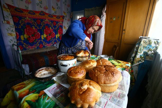 Yulia Panchenya, 82, makes Easter cakes on the eve of Orthodox Easter in the village of Pogost, Belarus.