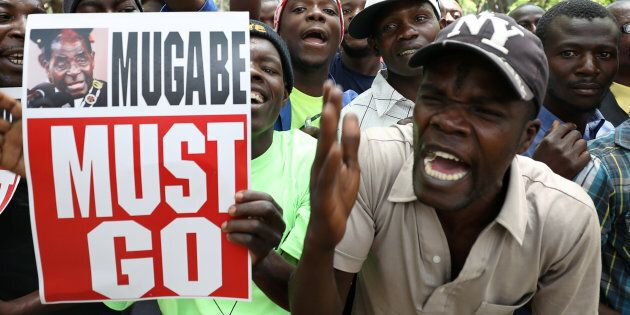 Protesters call for Zimbabwean President Robert Mugabe to