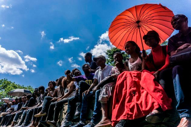 University of Zimbabwe's students take part in a demonstration on November 20, 2017 in Harare to demand...