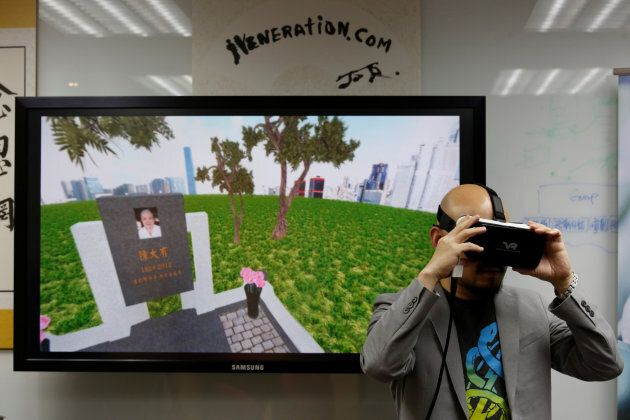 Anthony Yuen, CEO of iVeneration.com, demonstrates an augmented reality graveyard at his office in Hong Kong.