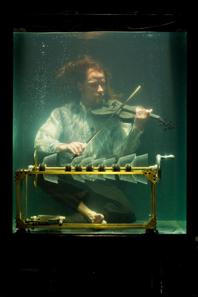 Robert Karlsson plays a violin specifically crafted for underwater use.