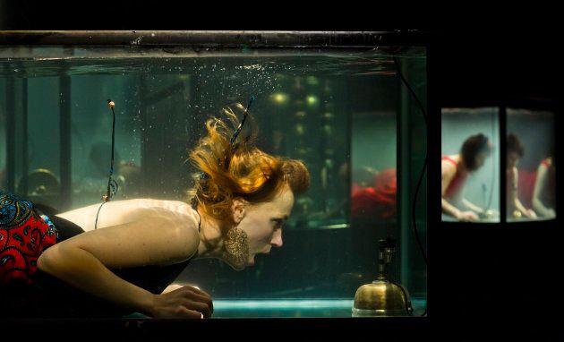 Performer Nanna Bech sings underwater.