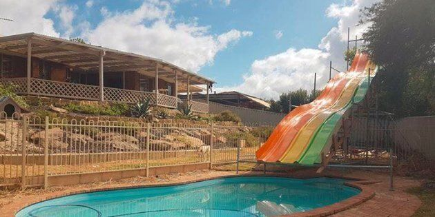 The water slide was built from the parts of an old indoor water park.