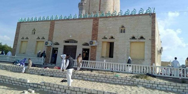 A bomb explosion ripped through the mosque before gunmen opened fire on the people