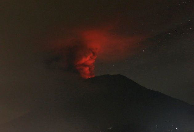 Mount Agung volcano is seen erupting from Glumpang village,