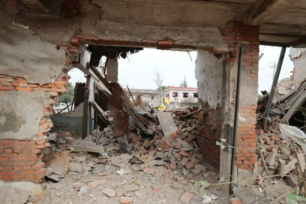 A damaged wall is seen at the site of a blast in Ningbo, Zhejiang