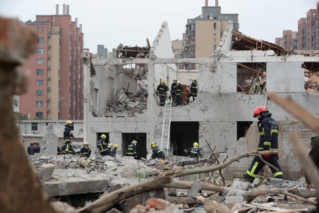 Rescue workers work at the site of a blast in